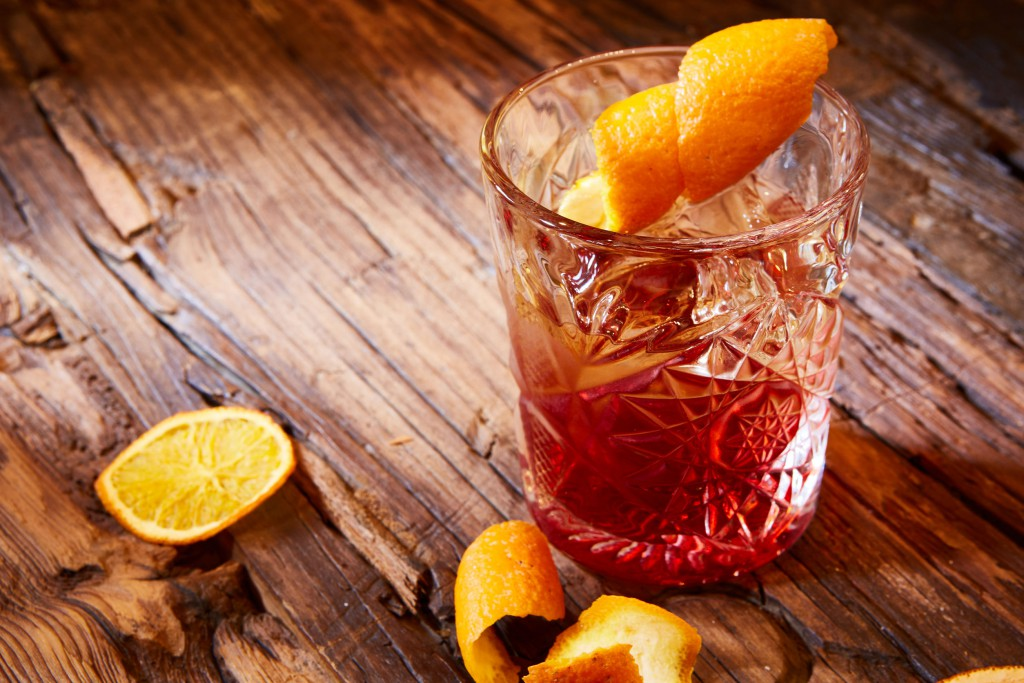 54926352 - old fashioned cocktail on the wooden background